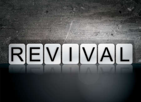 The word Revival written in white tiles against a dark vintage grunge background.