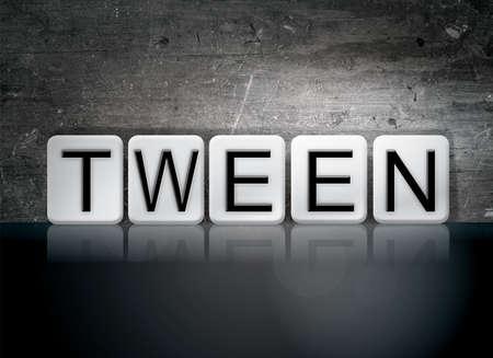 The word Tween written in white tiles against a dark vintage grunge background.