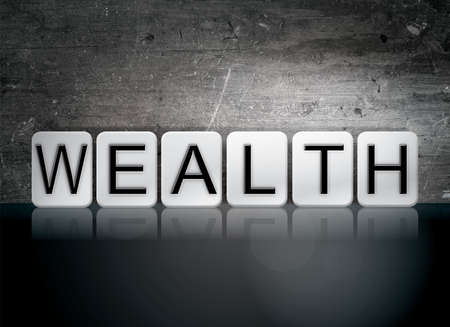 The word Wealth written in white tiles against a dark vintage grunge background.