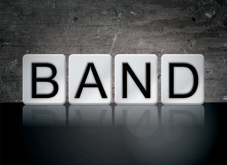 The word Band concept and theme written in white tiles on a dark background.