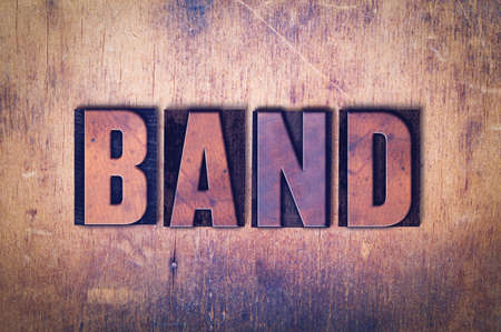 The word Band concept and theme written in vintage wooden letterpress type on a grunge background.