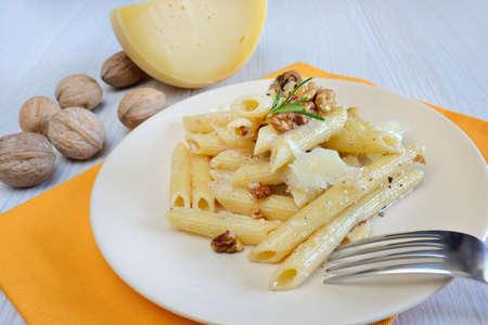 Italian rigatoni pasta with nuts cream and pecorino cheese