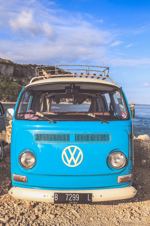 Photo for Bali, Indonesia - August 9, 2017 : Classic grey Volkswagen camper van or microbus a classic German utility vehicle built from 1950 and 1967 on the beach - Royalty Free Image