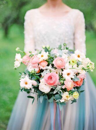 Foto für beautiful bride in white wedding dress with a bouquet. analog film photography - Lizenzfreies Bild