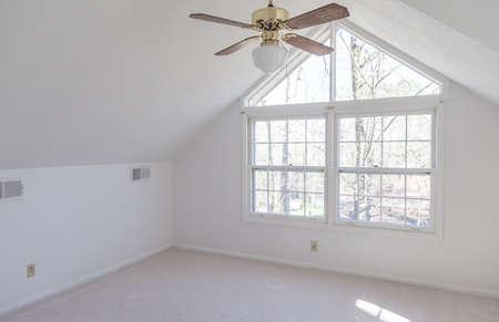 Freshly painted white empty loft bedroom