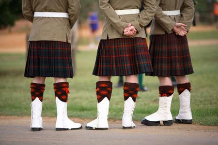 Three Scottish solders dressed in kilts