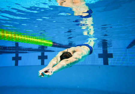 Swimmer in the Pool Underwater