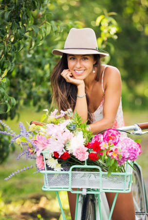 Photo pour Beautiful Girl on Bike in Countryside, Summer Lifestyle  - image libre de droit