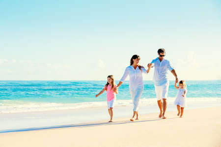 Photo pour Happy Family Having Fun on Beautiful Sunny Beach - image libre de droit