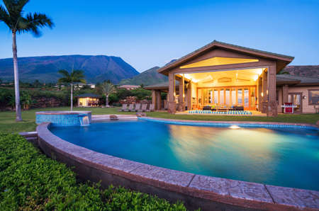 Photo for Luxury home with swimming pool at sunset - Royalty Free Image