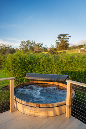 Beautiful wooden hot tub jacuzzi outdoors on deck