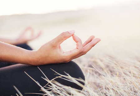 Woman meditating practicing yoga outdoors