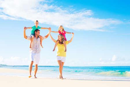 Photo pour Family of four having fun on tropical beach - image libre de droit