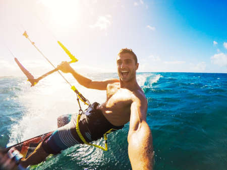 Kiteboarding. Fun in the ocean, Extreme Sport Kitesurfing. POV Angle with Action Cameraの写真素材