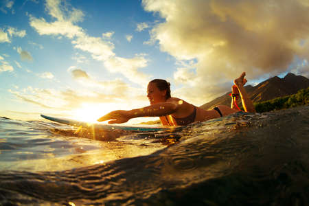 Foto de Surfing at Sunset. Outdoor Active Lifestyle. - Imagen libre de derechos