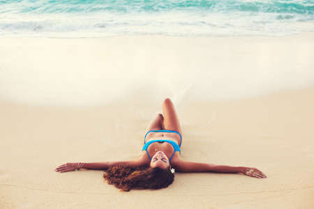 Summer Lifestyle, Beautiful Happy Carefree Young Woman Relaxing on the Beach at Sunset