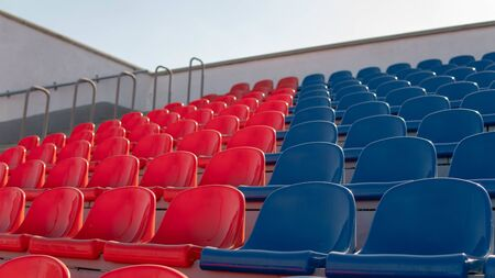 Photo pour Red and blue seats in a large street stadium. - image libre de droit
