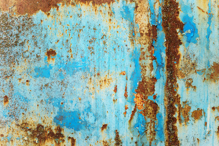 Photo pour Multicolored background: rusty metal surface with blue paint flaking and cracking texture - image libre de droit
