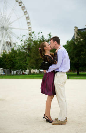 Romantic couple in Paris kissing near big dipper