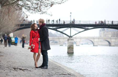 Romantic couple in love dating near Pont des Arts in Paris