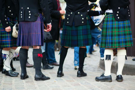 Men in traditional kilts