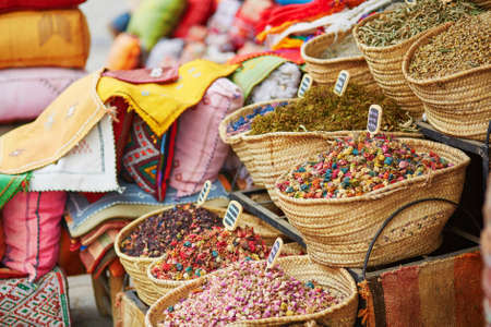 Selection of herbs and dry flowers on a traditional Moroccan market (souk) in Marrakech, Morocco