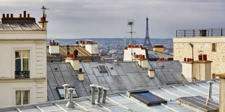 Photo pour Scenic view of Parisian roofs and Eiffel tower from Montmartre, focus on the Eiffel tower - image libre de droit