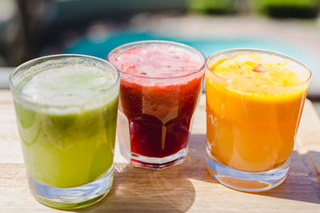 3 freshly pressed juices outside in sunlight