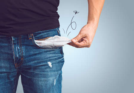 Poor man in jeans with empty pocket and drawn fly concept