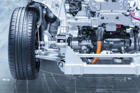 Photo pour Chassis of the electric, hybrid car with powertrain. Car maintenance. Blue toned. - image libre de droit