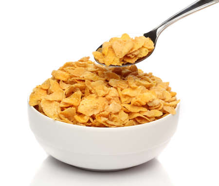 Cornflakes on a spoon over a bowl