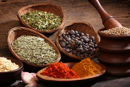Different spices over a wood background  Various colors and textures