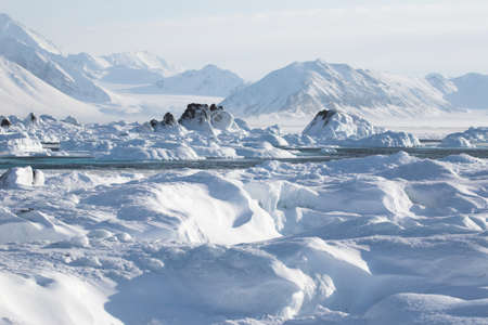 Arctic winter landscape - ice on the frozen fjord