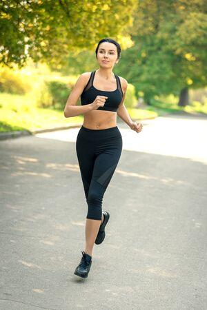 Foto de girl with dark hair in sportswear jogging. - Imagen libre de derechos