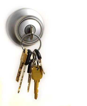 Photo for Keys in lock hanging from door knob - Royalty Free Image
