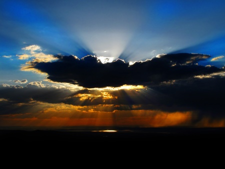Sunset clouds with sunlight beams adn colors