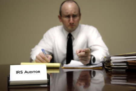 IRS tax auditor man with a stern or mean expression