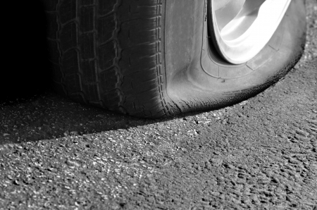 Detail Shot of a Flat Tire on a Car