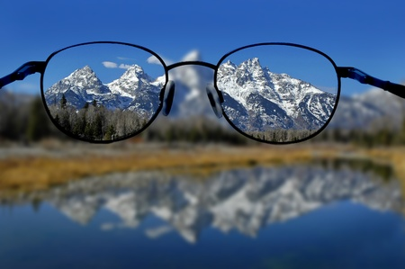 Glasses with clear vision of Teton Mountains in background