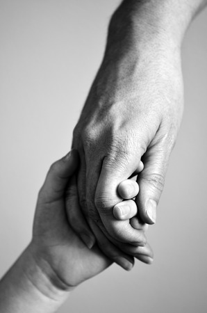 Photo for Adult or parent holding the hand of a small child - Royalty Free Image