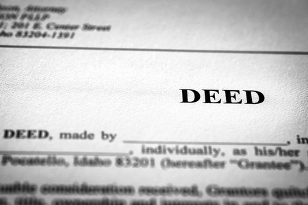 Photo pour Deed to real estate transfer title ownership to land or home - image libre de droit