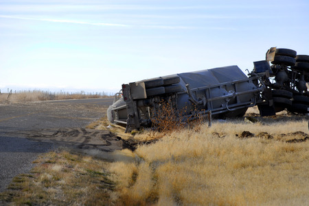 Photo pour Car wreck of semi truck trailer rolled over crash crashed wrecked rollover - image libre de droit