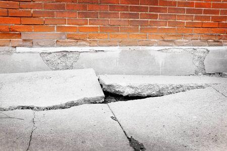 Photo for Broken sidewalk concrete crack dangerous cracked - Royalty Free Image