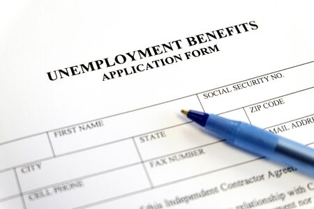 Photo for Written unemployment benefits application form - Royalty Free Image