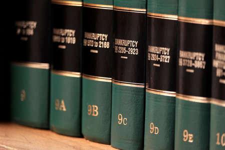 Photo pour Bankruptcy law books on shelf bookshelf for legal reference - image libre de droit