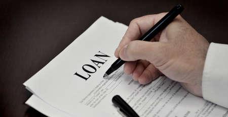 Photo pour Document loan or contract on a desk with a black pen - image libre de droit