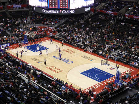 LOS ANGELES, NOVEMBER 25: Clippers vs. Kings: Kings player dribbles ball past Clippers player at Staples Center taken November 25 Los Angeles California.