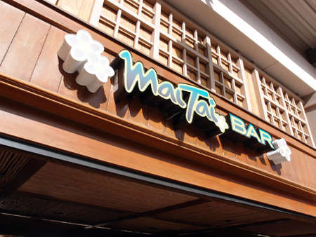 HONOLULU JANUARY 3: World Famous Mai Tai Bar sign in Ala Moana Shopping Center in Honolulu, Hawaii on Jan 3, 2014.   It is One of the hottest and most talked about bars in Honolulu, Daytona Beach and now Long Beach, the Mai Tai Bar embodies the spirit of