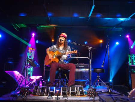 HONOLULU, HI - JUNE 15: Musician Tavana play guitar and sing on stage at Crossroads in Hawaiian Brian's with cool lighting on June 15 2016, Honolulu, Hawaii.