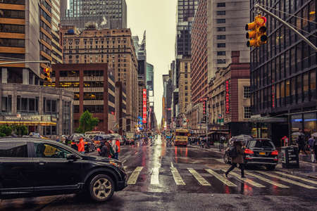 New York City, USA, March 2019, urban scene on the 7th Avenue on a rainy day in Manhattan